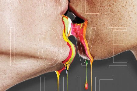Close-up of couple kissing with paint dripping from mouths